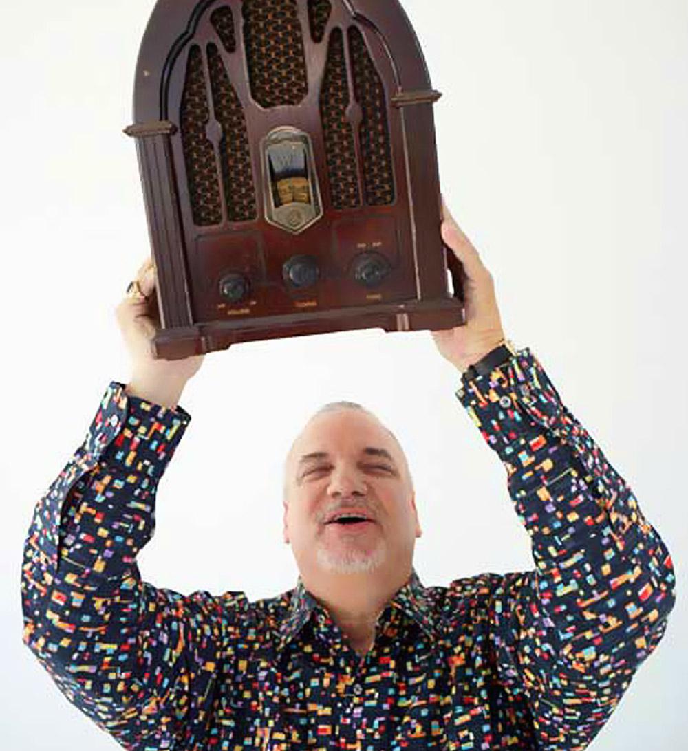 Doug Harris holding radio overhead